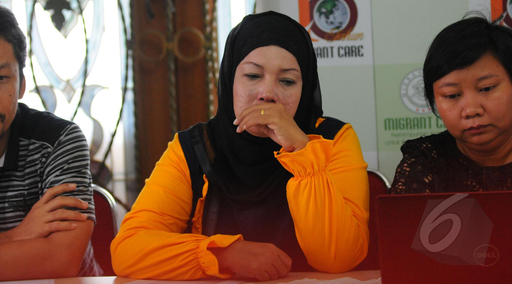 Een anak dari Ruyati (Ruyati adalah korban eksekusi mati di Arab Saudi pada 2011), Jakarta, Kamis (16/4/2015). Een ikut menghadiri konferensi pers yang diselenggarakan Migrant Care. (Liputan6.com/Herman Zakharia)