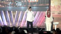 Calon Gubernur Jawa Timur Saifullah Yusuf dan Calon Wakil Gubernur Puti Guntur Soekarno mengangkat isu pendidikan gratis SMA/SMK Negeri (Liputan6.com/Dian Kuniawan)