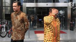 Wali Kota Gorontalo Marthen Taha dan Wakil Wali Kota Gorontalo Ryan Kono usai menyerahkan LHKPN di Gedung KPK, Jakarta, Senin (01/7/2019). Marten mengaku telah menyerahkan Perwako terkait pedoman pencegahan gratifikasi di lingkungan Pemerintah Kota (Pemkot) Gorontalo.  (merdeka.com/Dwi Narwoko)