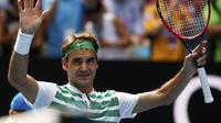 Petenis Swiss Roger Federer lolos ke semifinal Australia Open 2016 usai mengalahkan Tomas Berdych dari Republik Ceko, Selasa (26/1/2016). (Liputan6.com/REUTERS/Thomas Peter)
