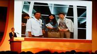 Jokowi pamer foto bareng Lee Min Ho. (Liputan6.com/Silvanus Alvin)