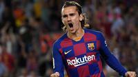 7. Antoine Griezmann (Barcelona) - Pemain berusia 28 tahun ini memiliki Kecepatan 86, Dribel 83, Umpan 84, Tembakan 88, Fisik 72, Kemampuan Bertahan 55, OVR 90. (AFP/Lluis Gene)