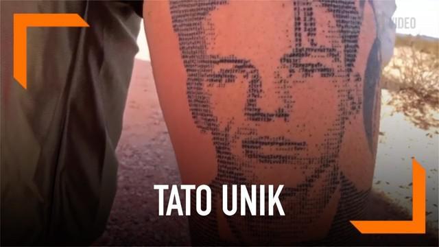 Seorang tato artis dari Cyprus, Andreas Vrontis menciptakan seni tato yang tak biasa. Ia melukis tato dengan menggunakan huruf dan angka kode komputer.