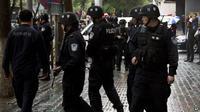 Polisi China berjaga. (BBC)