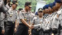 Kapolri Jenderal Pol Sutarman saat mengahadiri apel pengamanan pelantikan presiden dan wakil presiden di halaman Monumen Nasional, Jakarta, Jumat (17/10/2014) (Liputan6.com/Faizal Fanani)
