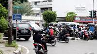 Rencananya semua jalan protokol di DKI Jakarta akan menjadi kawasan pembatasan kendaraan, Jakarta, Selasa (7/1/2015). (Liputan6.com/Faizal Fanani)