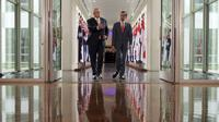 President Joko Widodo (right) and Australian Prime Minister Scott Morrison walk through a link as they leave the House of Representatives at the Parliament Building in Canberra, Australia Monday, February 10, 2020.  (Tracey Nearmy/Pool Photo via AP)