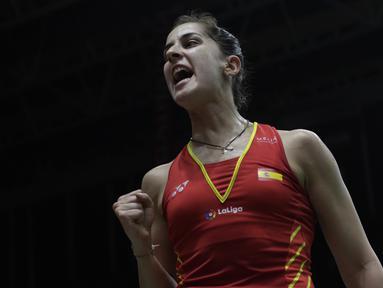 Tunggal putri Spanyol, Carolina Marin, merayakan kemenangan atas tunggal Korsel pada Indonesia Masters 2019 di Istora Senayan, Jakarta, Kamis (24/1). Marin lolos ke perempat final. (Bola.com/M. Iqbal Ichsan)