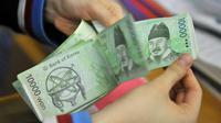 Won, mata uang Korea Selatan. (Sumber Foto: Jung Yeon-Je/AFP Photo)