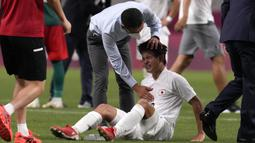 Takefusa Kubo. Sayap Jepang berusia 20 tahun ini mengoleksi 3 gol namun gagal membawa timnya merebut medali perunggu usai kalah 1-3 dari Meksiko. Ketiga gol dicetaknya di fase grup, masing-masing 1 gol saat melawan Afrika Selatan, Meksiko dan Prancis. (Foto: AP/Gregory Bull)