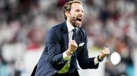 Pelatih Timnas Inggris, Gareth Southgate, meluapkan kebahagiaan usai membawa anak asuhnya mengalahkan Denmark pada laga semifinal Euro 2020 di Stadion Wembley, Kamis (8/7/2021). (Foto:AFP/Frank Augstein,Pool)