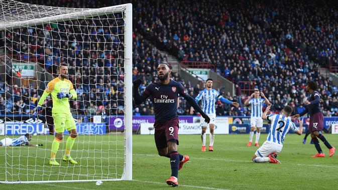Alexandre Lacazette merayakan golnya ke gawang Huddersfield Town. (AFP/Oli Scarff)#source%3Dgooglier%2Ecom#https%3A%2F%2Fgooglier%2Ecom%2Fpage%2F%2F10000