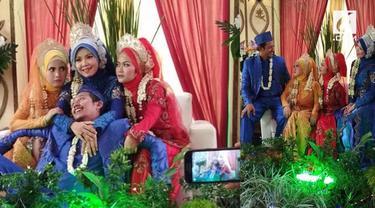 Sebuah video viral tentang pernikahan seorang pria dengan tiga wanita sekaligus.