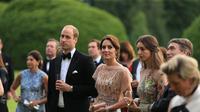 Rabu malam kemarin, Pangeran William dan Kate Middleton menghadiri gala dinner mewah di Houghton Hall.