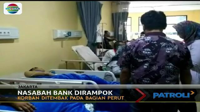 Nasabah Bank JadSeorang nasabah bank menjadi korban perampokan di Kawasan Ciracas, Jakarta Timur.i Korban Perampokan di Ciracas (Patroli Siang)