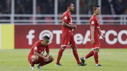 Gelandang Persija Jakarta, Nugroho, tampak lesu usai dikalahkan Ceres-Negros pada laga Piala AFC 2019 di SUGBK, Jakarta, Selasa (23/4). Persija takluk 2-3 dari Ceres-Negros. (Bola.com/M Iqbal Ichsan)