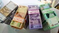 """Menyisihkan uang Rp 10.000 per hari untuk """"menabung"""" di reksa dana berpotensi menghasilkan jutaan rupiah."""