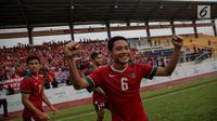 Pemain timnas U-22 Evan Dimas Darmono usai menang melawan Myanmar dalam laga final perebutan medali perunggu Sea Games 2017 di Stadion MPS, Selayang, Malaysia, Selasa (29/8). Indonesia menang dengan skor 3-1. (Liputan6.com/Faizal Fanani)