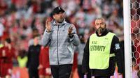 Jurgen Klopp puas pada performa pemain muda Liverpool. (AFP / SAEED KHAN)