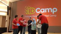 Presiden Direktur Indosat Ooredoo Ahmad Abdulaziz A A Al-Neama beserta jajarannya meluncurkan program IDCamp, pemberian 10.000 beasiswa coding untuk anak muda di Indonesia. (Liputan6.com/ Agustin Setyo W)