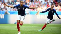 Striker Prancis, Kylian Mbappe, merayakan gol ke gawang Argentina pada laga 16 besar Piala Dunia di Kazan Arena, Kazan, Sabtu (30/6/2018). Prancis menang 4-3 atas Argentina. (AFP/Franck Fife)