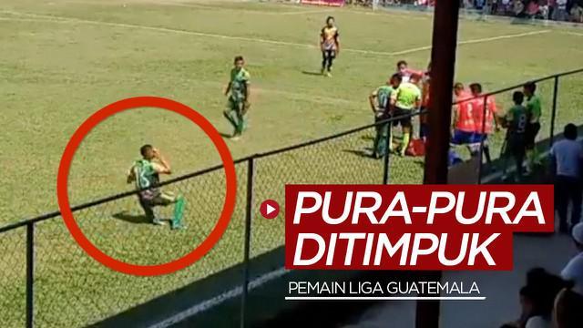 Berita video pemain Liga Guatemala, Rosbin Ramos, melakukan aksi pura-pura ditimpuk batu oleh suporter dalam laga di mana tidak adanya VAR (Video Assistant Referee).