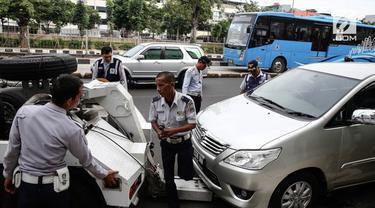 Pemprov DKI Jakarta akan mewajibkan setiap pemilik mobil untuk memiliki garasi