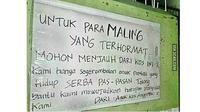 Tulisan Dilarang Maling (Sumber:1cak)