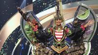 Penampilan Aurra Kharisma dengan gaun bertemakan sate di panggung Miss Grand Internasional 2020. (Dok. Instagram @officialglobalbeauties/ https://instagram.com/officialglobalbeauties?igshid=184pl8kjikw4y/ Dinda Rizky)