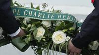 Peringatan tiga tahun tragedi Charlie Hebdo. (AP Photo/ Christian Hartmann)