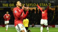Pemain Manchester United, Jesse Lingard mencetak satu gol saat timnya menang atas Watford pada lanjutan Premier League di Vicarage Road stadium, Watford, (28/11/2017). MU menang 4-2. (AFP/Glyn Kirk)