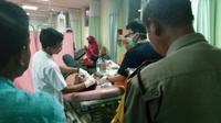 Anggota Provos Polsek Tanah Abang menjadi korban pengeroyokan di Kampung Bahari, Tanjung Priok. (Liputan6.com/Ika Defianti)
