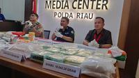 Puluhan kilogram sabu dan ratusan ribu butir pil ekstasi sitaan Polda Riau selama Operasi Anti Narkoba. (Liputan6.com/M Syukur)