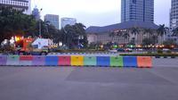 Suasana di dekat Patung Kuda usai massa aksi membubarkan diri dengan tertib. (Liputan6.com/Ady Anugrahadi)