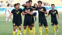 Pemain Timnas Malaysia U-23 merayakan gol Muhammad Safawi Rasid (11). (Bola.com/Twitter Ong Kim Swee)
