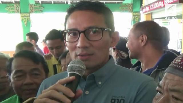 Sandiaga Uno memberikan reaksi ini saat ditanya tentang momen pelukan Presiden Jokowi dan Prabowo Subianto pada ajang Asian Games 2018.
