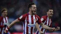 Gelandang Atletico Madrid Saul Niguez merayakan gol ke gawang Las Palmas pada laga La Liga di Stadion Vicente Calderon, Madrid, Sabtu (17/12/2016). (AFP/Javier Soriano)