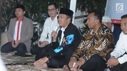 Menpora Imam Nahrawi memberi sambutan jelang buka puasa bersama para atlet pelatnas Asian Games 2018 di Jakarta, Senin (28/5). Acara tersebut dihadiri atlet pelatnas Asian Games 2018 dan para mantan atlet peraih medali. (Liputan6.com/Helmi Fithriansyah)
