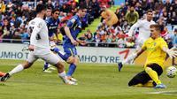 Isco mencetak gol kedua Real Madrid ke gawang Getafe dalam lanjutan Liga Spanyol di Coliseum Alfonso Perez, Sabtu malam WIB (16/4/2016). (Liputan6.com/REUTERS/Sergio Perez)