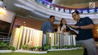 Sebuah maket plan yang mengusung konsep Transit Oriented Development digelar pada pameran properti LRT City Expo di Jakarta, Sabtu (21/7). Anak usaha dari PT Adhi Karya, Adhi Commuter Propertimenargetkan penjualan pemasaranRp 19 miliar. (Liputan6.com)