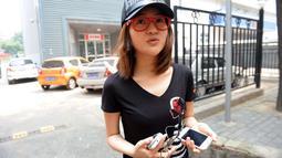 Selain menjalani bisnis judi ilegal, wanita 23 tahun itu mengaku meraup banyak uang karena bekerja sebagai wanita panggilan. (CHINA OUT AFP PHOTO)