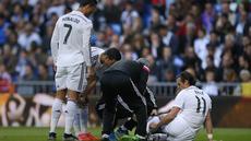 Winger Madrid Gareth Bale sedang dipantau kondisinya oleh tim dokter karena mengalami cedera. (AP Photo/Andres Kudacki)