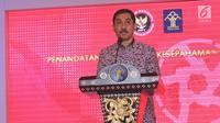 Kepala BNPT Suhardi Alius memberikan sambutan saat melakukan MoU di gedung Kemenkumham, Jakarta, Kamis (31/5). Kerja sama tersebut terkait dengan penanggulangan tindak pidana terorisme.  (Liputan6.com/Herman Zakharia)