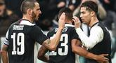 Para pemain Juventus merayakan gol yang dicetak Cristiano Ronaldo ke gawang Udinese pada laga Serie A di Stadion Allianz, Turin, Minggu (15/12). Juventus menang 3-1 atas Udinese. (AFP/Isabella Bonotto)