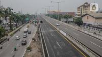 Kendaraan melintasi jalan tol Kebon Bawang, Tanjung Priok, Jakarta, Kamis (5/11/2020). Tarif baru Tol Jakarta Outer Ring Road (JORR) I, Jalan Tol Akses Tanjung Priok (ATP) dan Jalan Tol Pondok Aren-Ulujami mengalami kenaikan Rp 1.000 hingga Rp 1.500 dalam waktu dekat. (Liputan6.com/Faizal Fanani)
