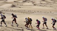 (Ilustrasi) Hanya dengan menggunakan kaus kaki, Ibrahim Mukunga Wachira, pria berusia 27 tahun dari Kenya, memenangkan lomba lari 23 kilometer. (JEAN-PHILIPPE KSIAZEK/AFP)