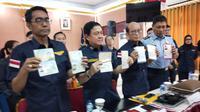 Kemenhumham Kanwil Sumsel menahan 20 orang turis asing yang menyalahgunakan visa wisata di Palembang (Liputan6.com / Nefri Inge)