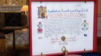 Instrument of Consent, surat persetujuan resmi Ratu Elizabeth II terhadap pernikahan Pangeran Harry dan Meghan Markle (AP Photos/Victoria Jones)