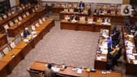 Suasana uji kelayakan terhadap calon Hakim Agung Tata Usaha Negara (TUN) khusus pajak Triyono Martanto di ruang rapat Komisi III DPR RI, kompleks Parlemen, Jakarta, Rabu (27/1/2021). Komisi III menghentikan uji kelayakan terhadap Triyono setelah diduga melakukan plagiat. (Liputan6.com/Angga Yuniar)
