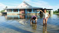 Banjir akibat naiknya permukaan laut di Kepulauan Pasifik (AP/Kyodo)